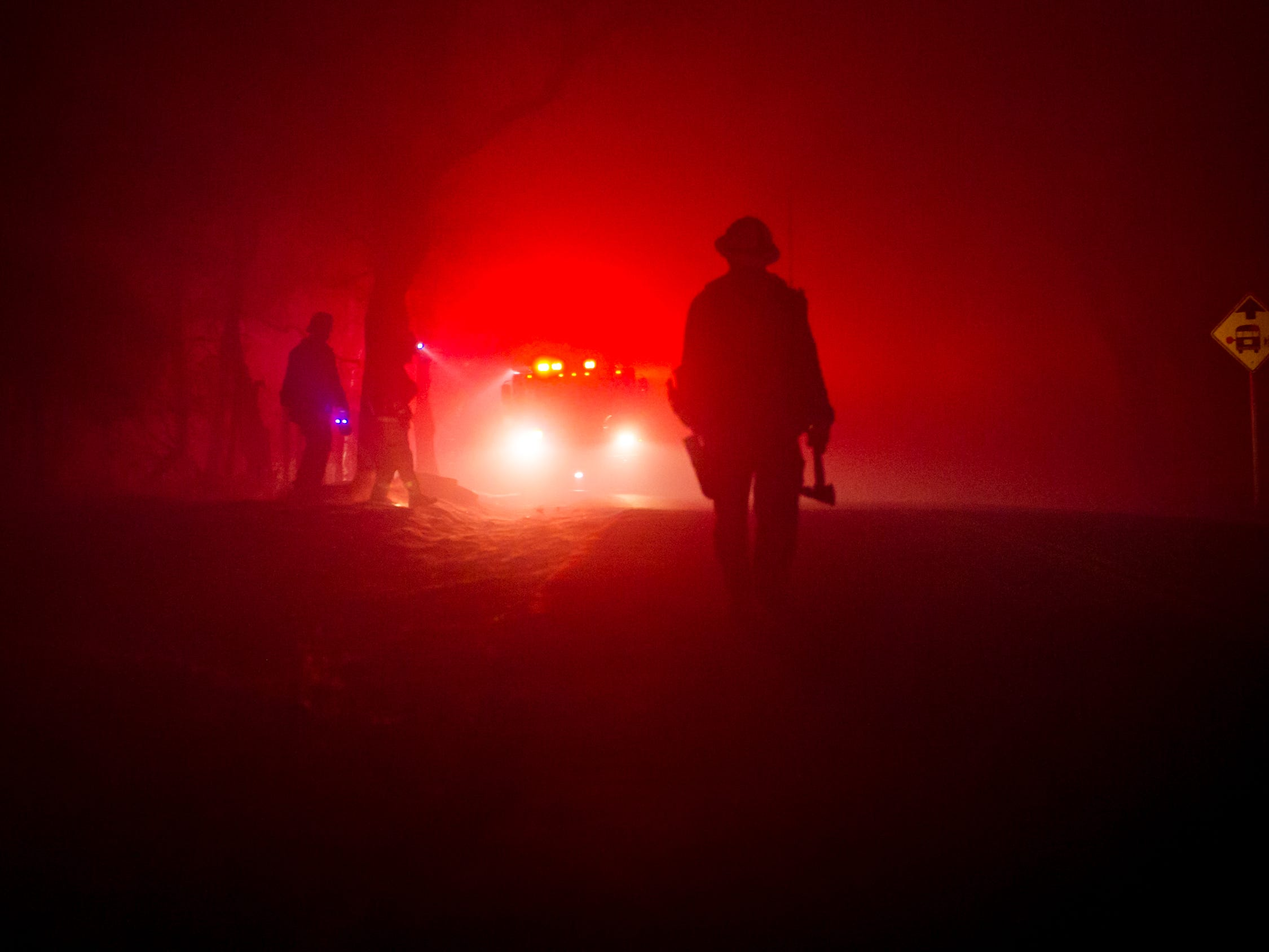 Firefighters continue to work 24-hour shifts battling the Camp Fire blaze near Butte Valley, Calf., Monday, Nov. 12, 2018.