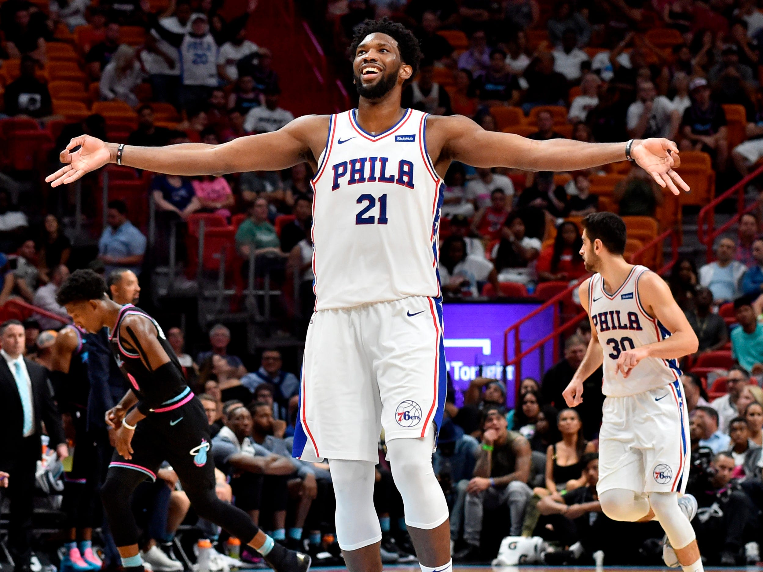Nov. 12: 76ers center Joel Embiid celebrates after hitting a 3-pointer during the second half against the Heat in Miami.