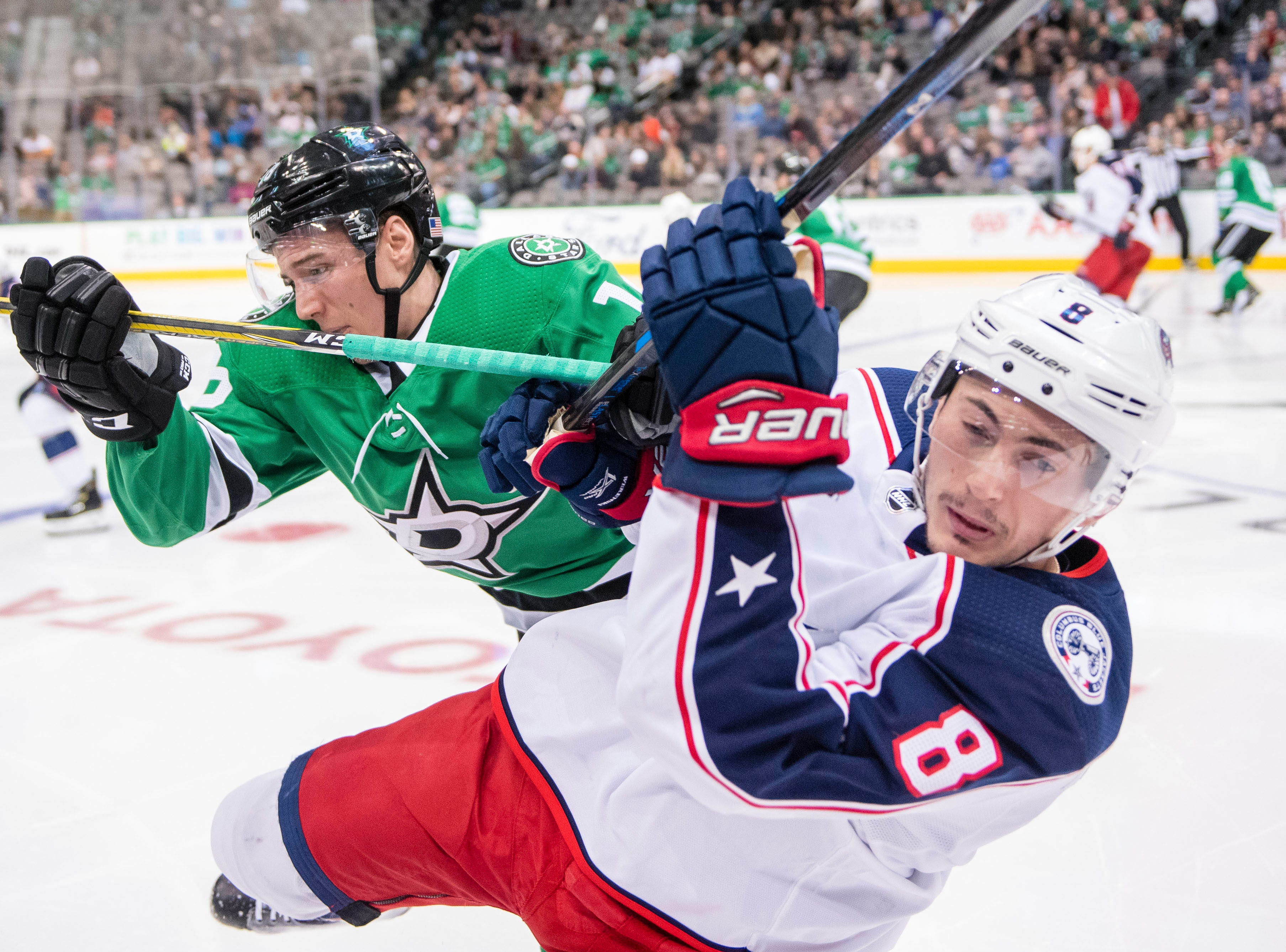 Nov. 12: Dallas Stars center Tyler Pitlick (18) checks Columbus Blue Jackets defenseman Zach Werenski (8) during the third period at the American Airlines Center.