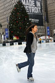 A skater enjoys skating at Campus Martius Park in downtown Detroit. After a stretch of brutal weather, folks should be able to get out and enjoy the mild weather that's forecast for the weekend.
