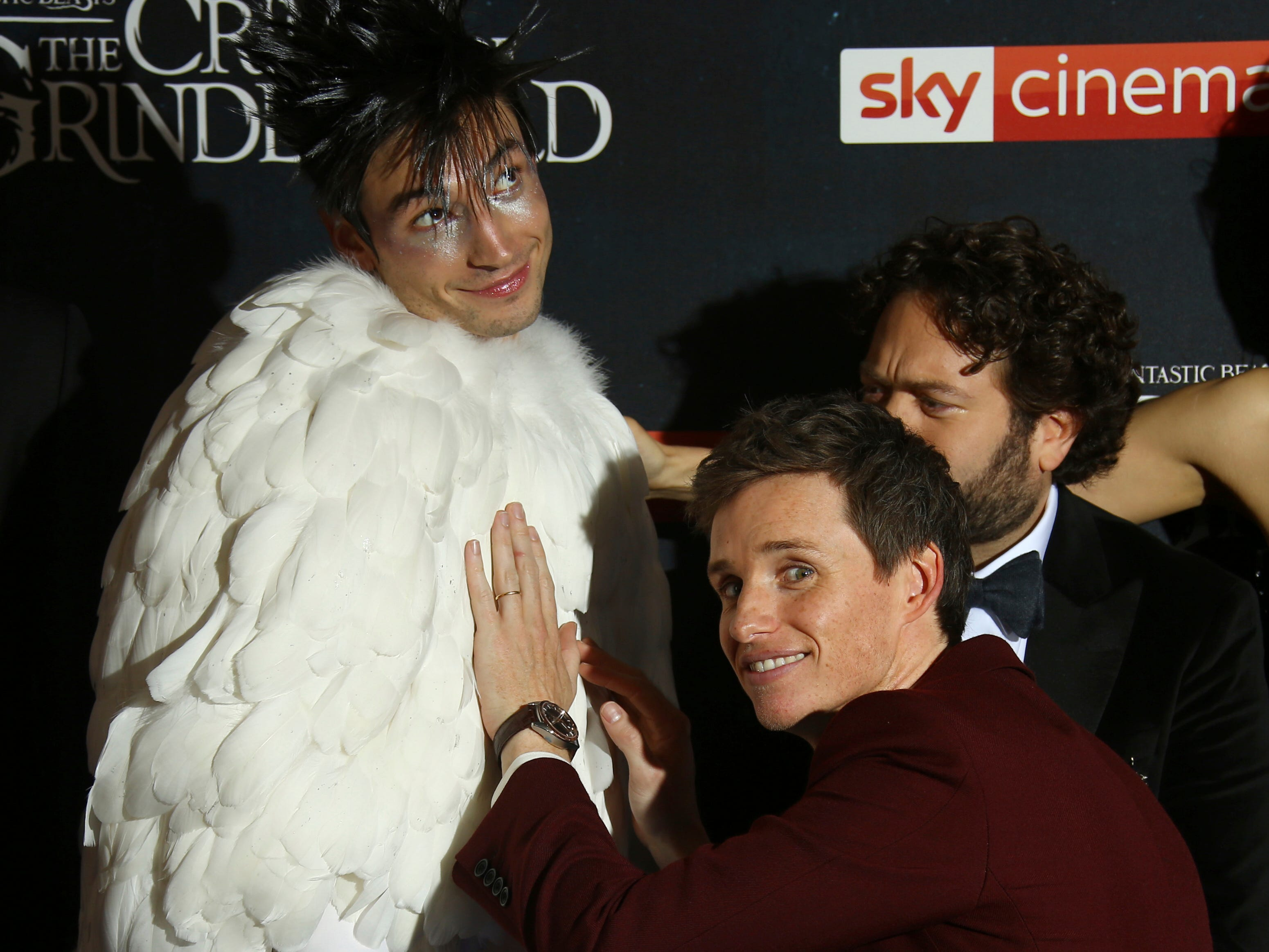 Actor Eddie Redmayne, right, jokes with fellow actor Ezra Miller as they pose for photographers upon arrival at the premiere of the film 'Fantastic Beasts: The Crimes of Grindelwald', at a central London cinema, Tuesday, Nov. 13, 2018.