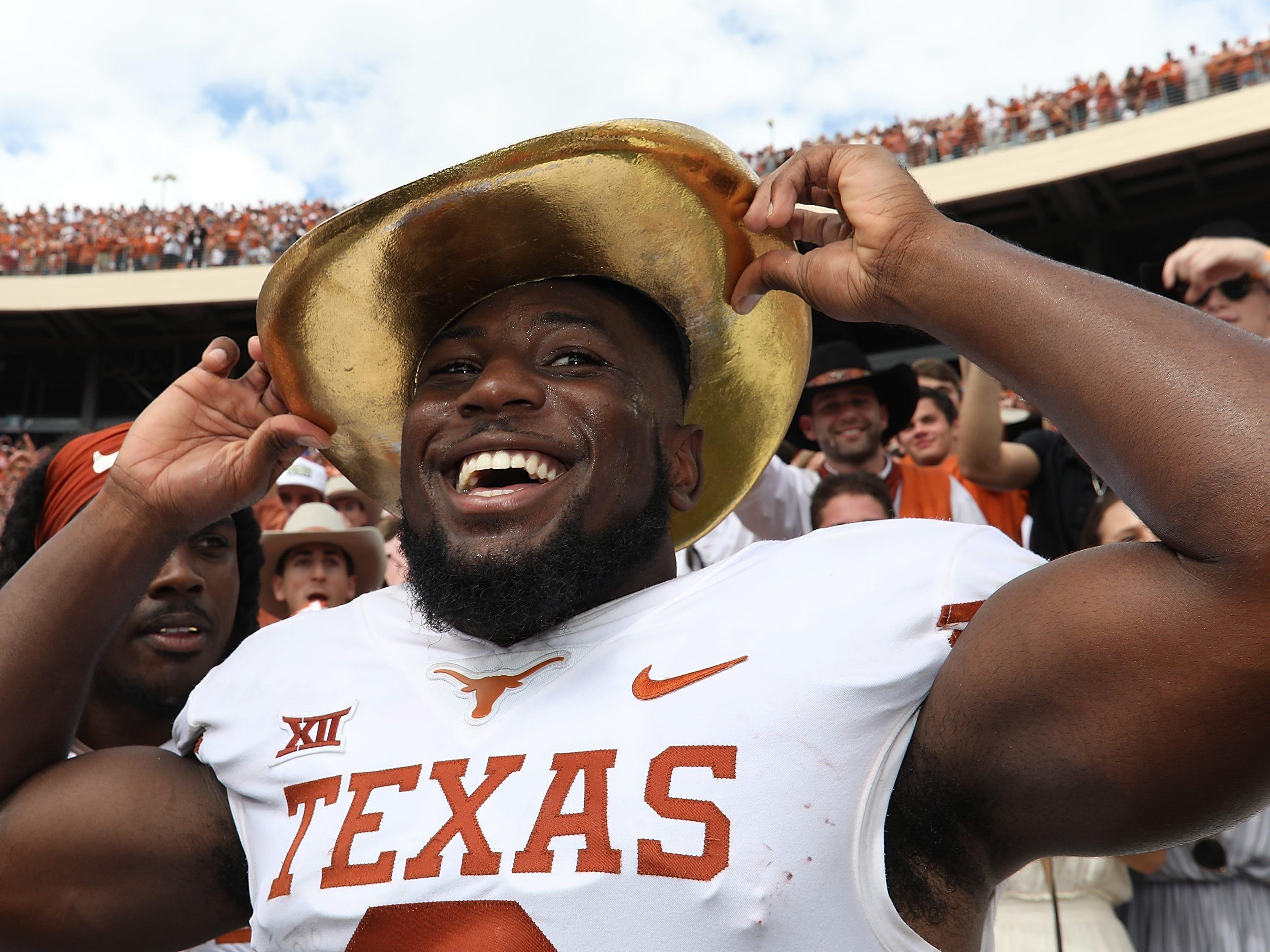 Golden Hat: Texas' Kris Boyd wears the Golden Hat trophy after a 48-45 win against Oklahoma in the Red River Showdown at the Cotton Bowl on Oct. 6.