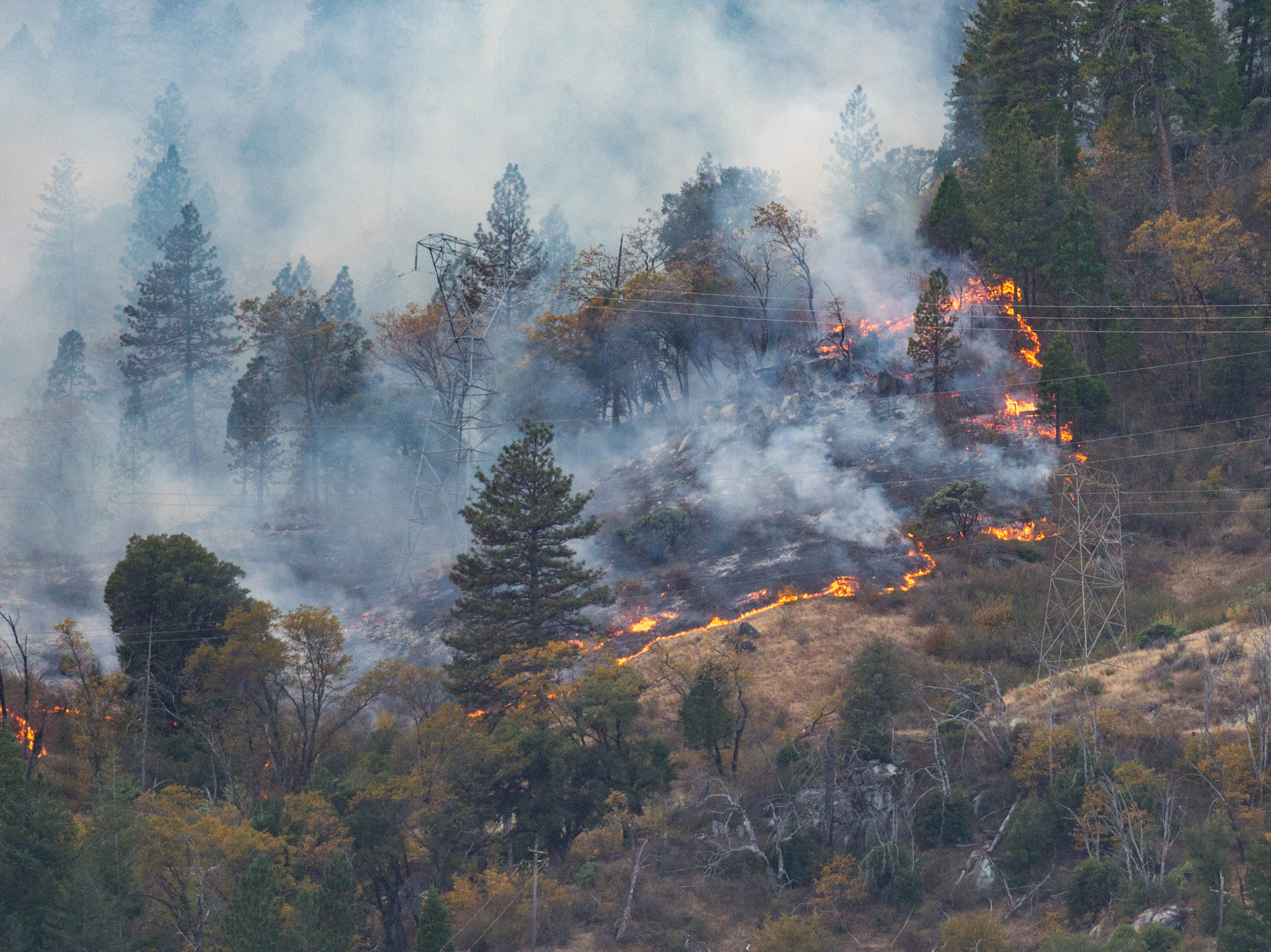 The Camp Fire continues to burn near Butte Valley, Calf., Monday, Nov. 12, 2018.