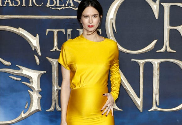 Katherine Waterston holds her baby bump at the UK Premiere of 'Fantastic Beasts: The Crimes Of Grindelwald' at Cineworld Leicester Square on November 13, 2018 in London, England.