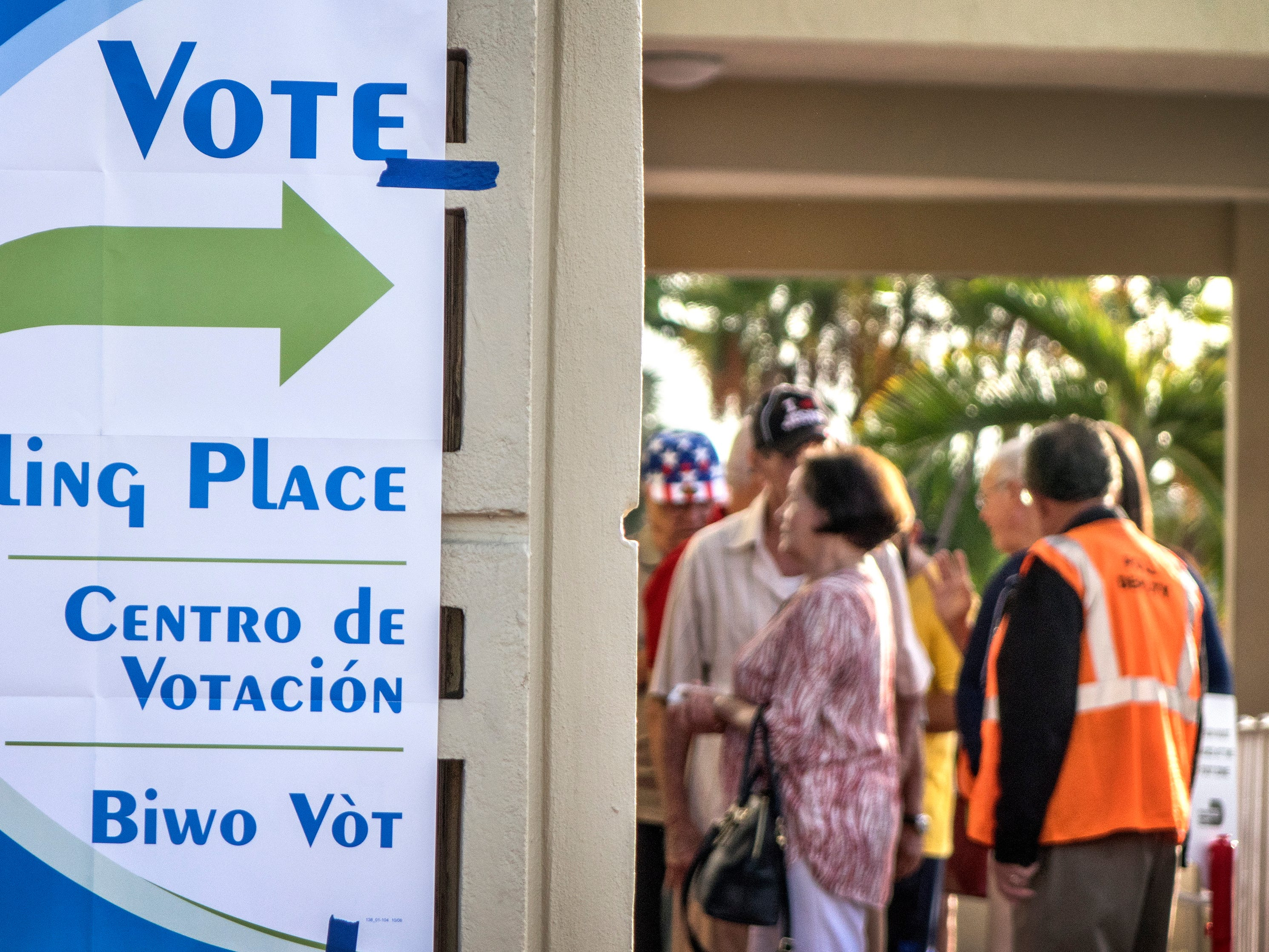 Voters wait in line to cast their ballots in the midterms in Hialeah, Florida on Nov. 6.