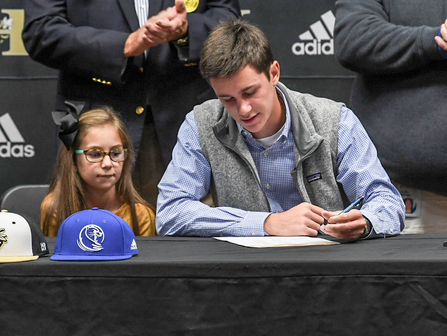 Jackson Bryant signs a letter of intent to play baseball at the Lander University, during a National Signing Day event at T.L. Hanna High School in Anderson on Wednesday.