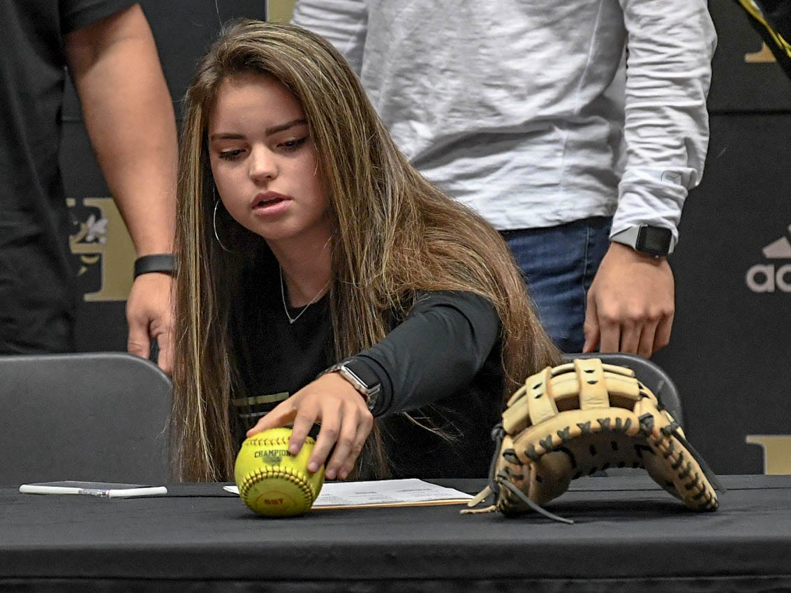 Yes Laureano signs a letter of intent to play softball at the Anderson University, during a National Signing Day event at T.L. Hanna High School in Anderson on Wednesday.