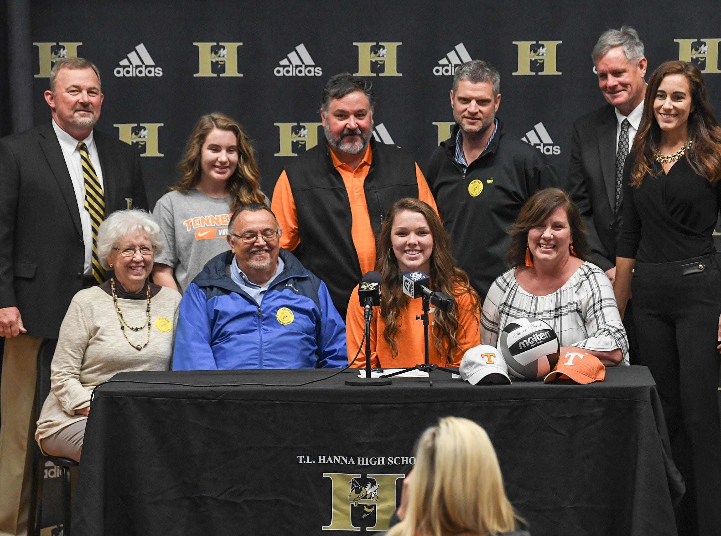 Maddie Bryant signs a letter of intent to play volleyball at the University of Tennessee, during a National Signing Day event at T.L. Hanna High School in Anderson on Wednesday.
