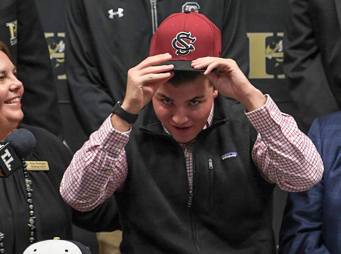 Will McGregor signs a letter of intent to play baseball at the University of South Carolina, during a National Signing Day event at T.L. Hanna High School in Anderson on Wednesday.