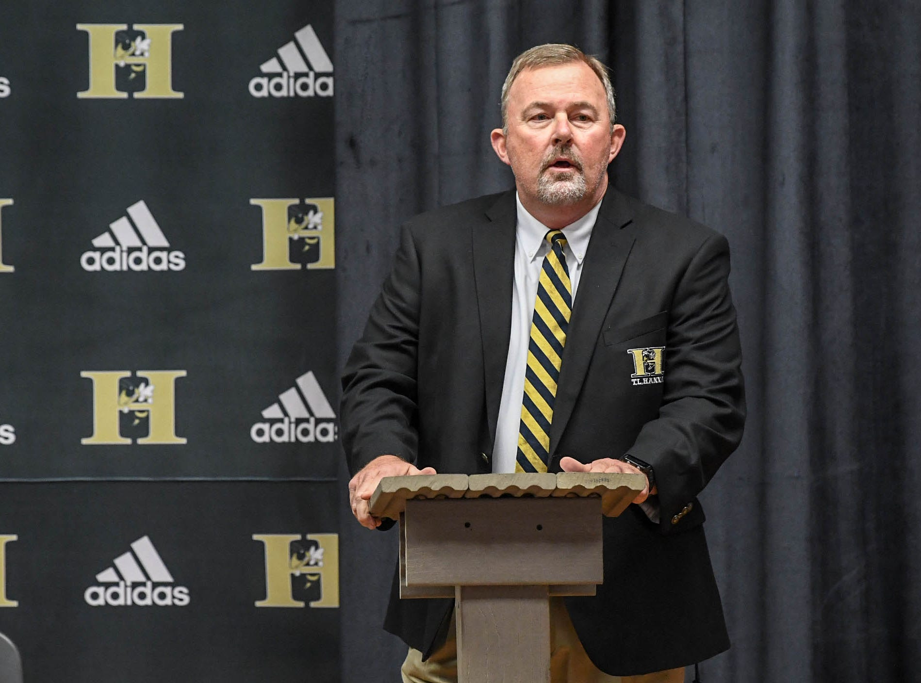 John Cann, T.L. Hanna High Athletic Director, speaks during a National Signing Day event at T.L. Hanna High School in Anderson on Wednesday.