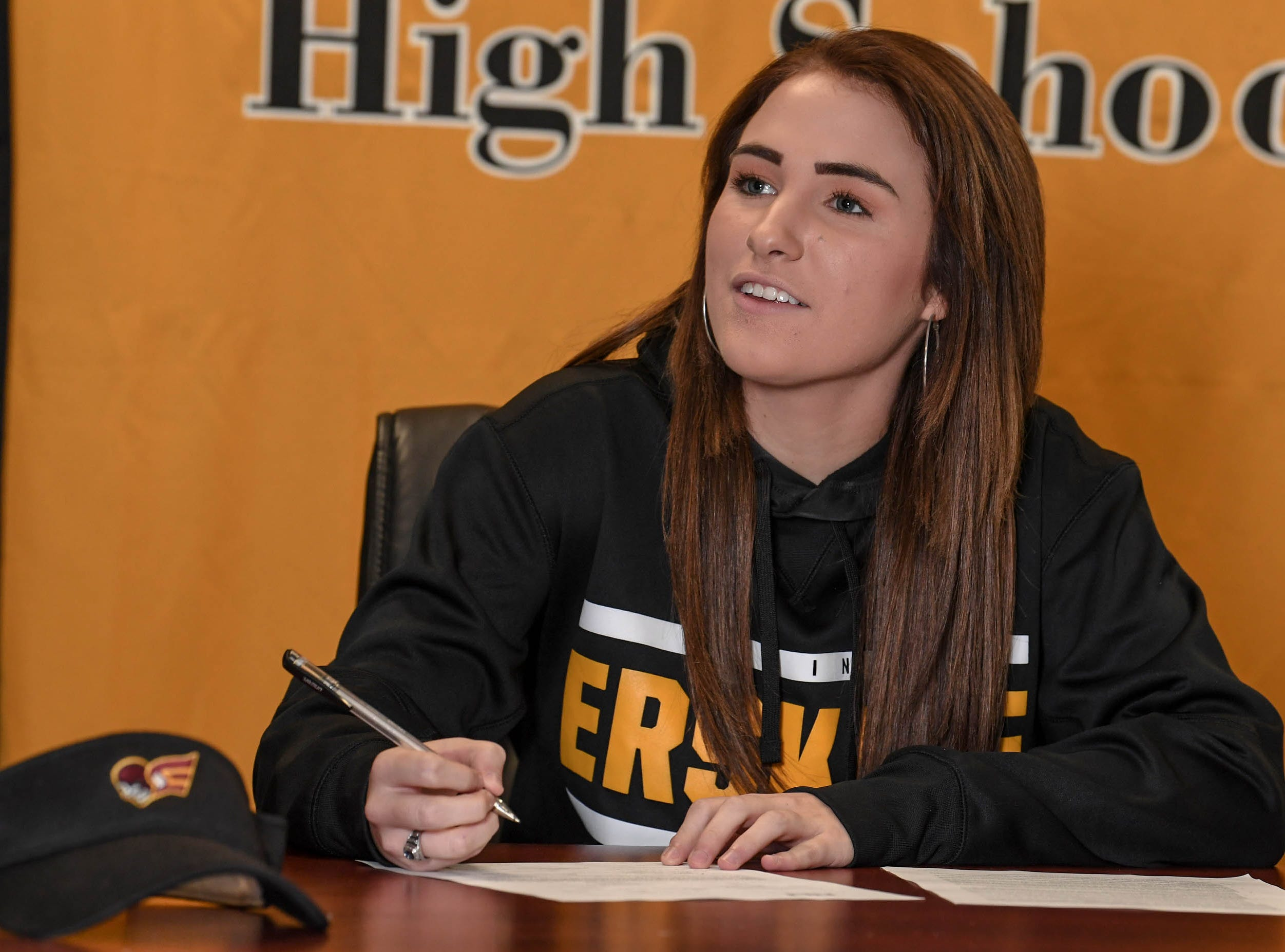 Crescent High School softball player Katie Spires signs a National Letter of Intent to play at Erskine College, during a National Signing Day event at Crescent High School in Iva on Wedesday.