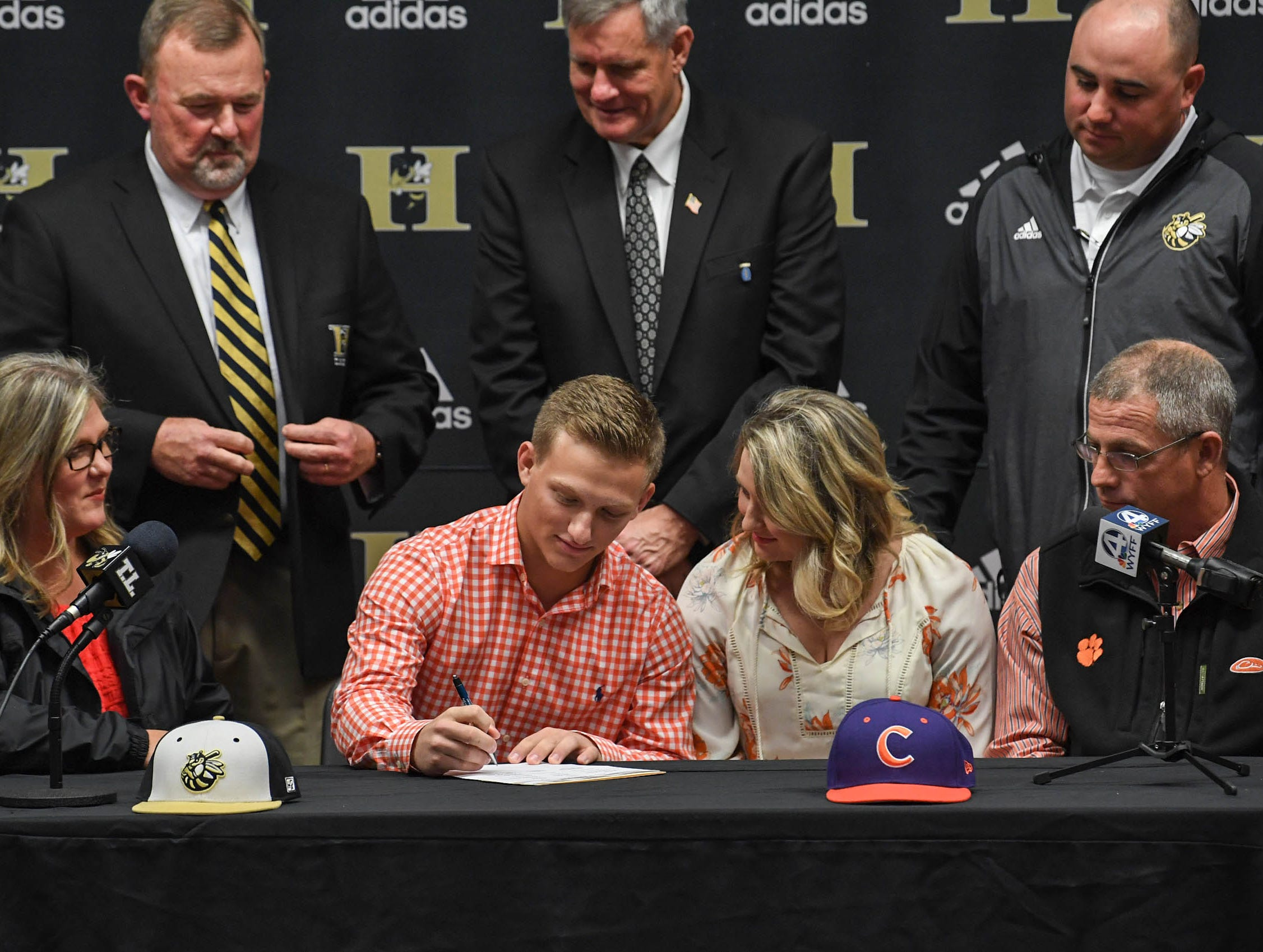 Regan Reid signs a letter of intent to play baseball at the Clemson University, during a National Signing Day event at T.L. Hanna High School in Anderson on Wednesday.