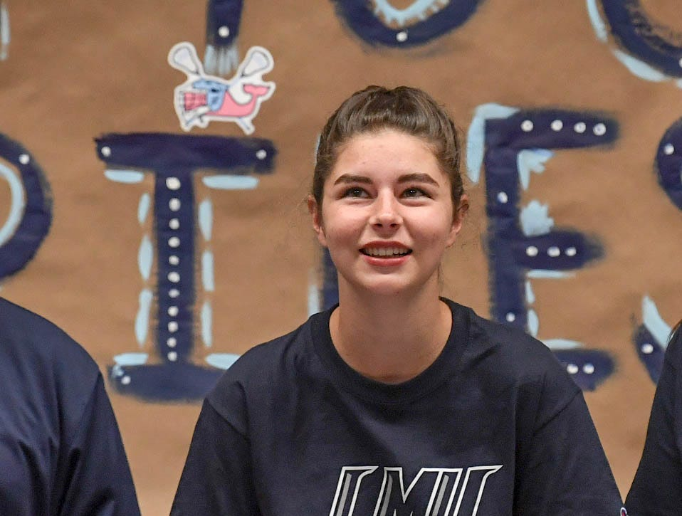 Riley Manuel signs a letter of intent to play lacrosse at the Lincoln Memorial University, during a National Signing Day event at T.L. Hanna High School in Anderson on Wednesday.