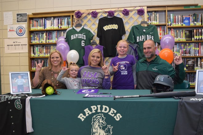 "Rapides High School's Sydney Lewis (third from left) and her family: mom Amy Lewis (far left); sisters Annabelle Lewis (second from left) and Ryan Lewis (second from right) and dad Heath Lewis show ""Fork 'Em Demon"" hand signs after Sydney signed papers to play softball for Northwestern State University."