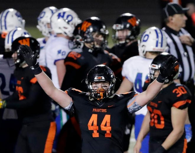 West De Pere's Jake Karchinski celebrates after the Phantoms defeated Notre Dame 17-3 in a WIAA Division 3 state quarterfinal game Nov. 2 in De Pere. The Phantoms play Catholic Memorial in Friday's championship game at Camp Randall Stadium in Madison.