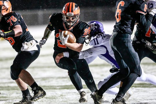 Iola-Scandinavia's Carter Kurki avoids being tackled by Grantsburg's Luke Anderson (11) in last Friday's WIAA state semifinal at Chippewa Falls. Iola-Scandinavia plays Racine Lutheran in Thursday's Division 6 state championship game.