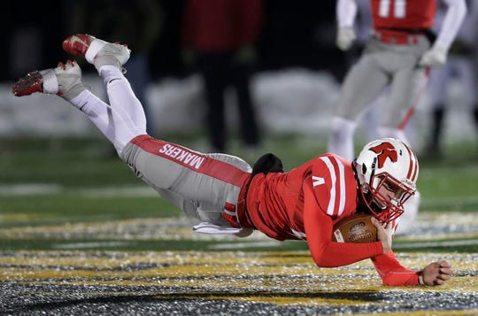 Kimberly's Cody Staerkel dives for a first down against Fond du Lac during last Friday's Division 1 state semifinal at Titan Stadium in Oshkosh. Kimberly plays Muskego in Friday's state championship game at Camp Randall Stadium in Madison.