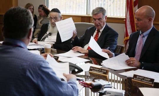 (Left to right) Commissioner Rabbi Israel Schenkolewski, Chairman George Gilmore and Commissioner Matthew R. Sage talk with Ocean County Board of Elections officials Wednesday in Toms River as they met to review provisional ballots from last week's election.
