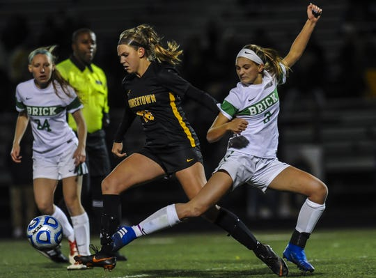 Reese Beggs of Brick Twp. battles for the ball with Grace Hurren of Moorestown in the NJSIAA Girls Soccer State Semifinals  in Toms River on Nov. 13, 2018.