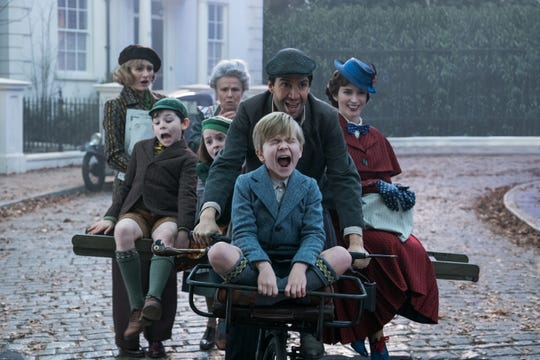 "Jane (Emily Mortimer), from left, John (Nathanael Saleh), Annabel (Pixie Davies, Ellen (Julie Walters), Jack (Lin-Manuel Miranda), Georgie (Joel Dawson) and Mary Poppins (Emily Blunt) in ""Mary Poppins Returns."""