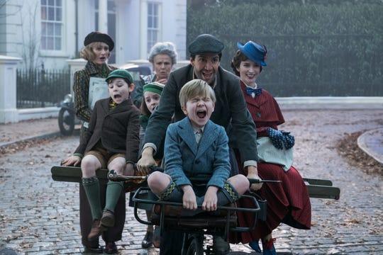 "Jane (Emily Mortimer), from left, John (Nathanael Saleh), Annabel (Pixie Davies, Ellen (Julie Walters), Jack (Lin-Manuel Miranda), Georgie (Joel Dawson) and Mary Poppins (Emily Blunt) in ""Mary Poppins Returns."""