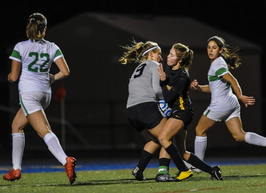 Brick Twp goalkeeper Molly Tully collides with Rylee Brown of Moorestown making a save in the NJSIAA Girls Soccer State Semifinals  in Toms River on Nov. 13, 2018.