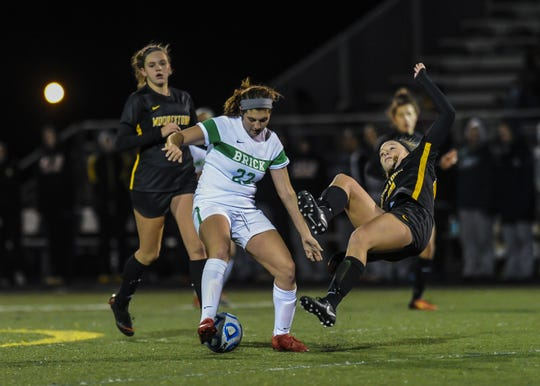 Tierney Garkowski of Brick Twp. collides with Ashley Nutt of Moorestown in the NJSIAA Girls Soccer State Semifinals  in Toms River on Nov. 13, 2018.