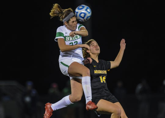 Tierney Garkowski of Brick Twp. battles for a header with Abbey McNulty of Moorestown in the NJSIAA Girls Soccer State Semifinals  in Toms River on Nov. 13, 2018.