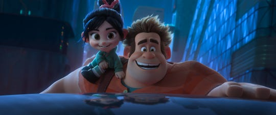 "John C. Reilly as the voice of Ralph, right, and Sarah Silverman as the voice of Vanellope,  star in ""Ralph Breaks the Internet."""