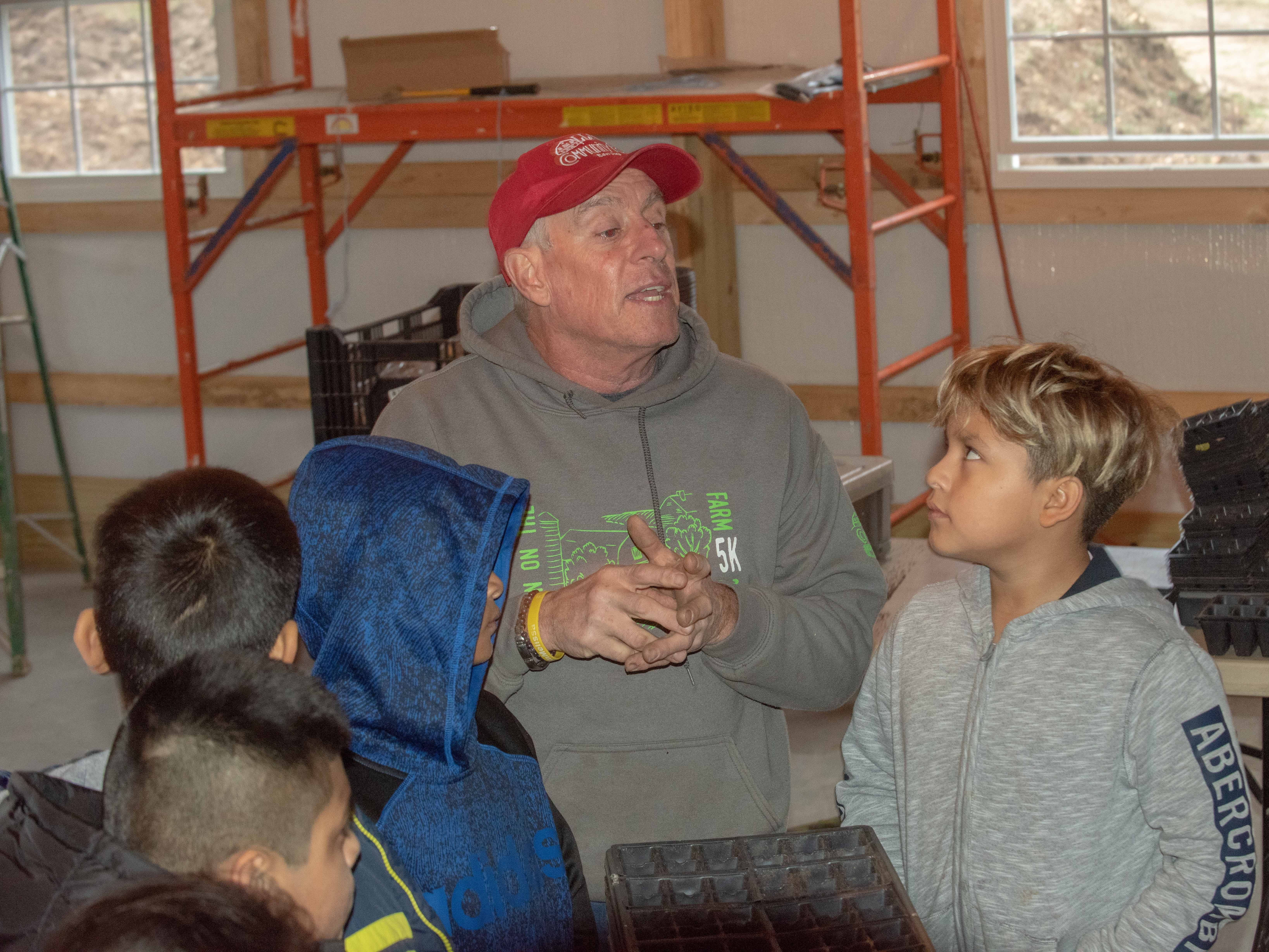 11/13/18- Sean Burney (center) co-founder of Allaire Community Farm, Wall Twsp., explains about preparing plantings to students from Woodrow Wilson school in Neptune City and 21st Century after school program , Bradley elementary school in Asbury Park. photo/James J. Connolly/Correspondent