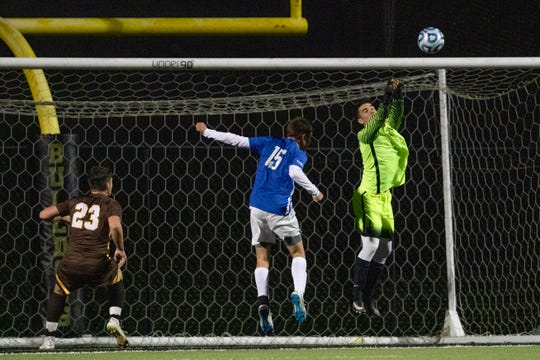 Holmdel goalie Jack Murray knocks ball away from front of net with help from team mate Jack Russo. Holmdel defeats Delran 2-1 in South Group II boys soccer semifinal in Hopewell, NJ on November 13, 2018.