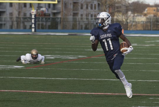 Mater Dei's Eddie Lewis takes a lateral and heads down the sideline for the game-winning touchdown in the 2016 NJSIAA Non-Public Group II Championship game at Kean University in Union.