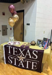 A table is decorated for Wylie's Caleb Munton, who signed Wednesday with Texas State baseball.