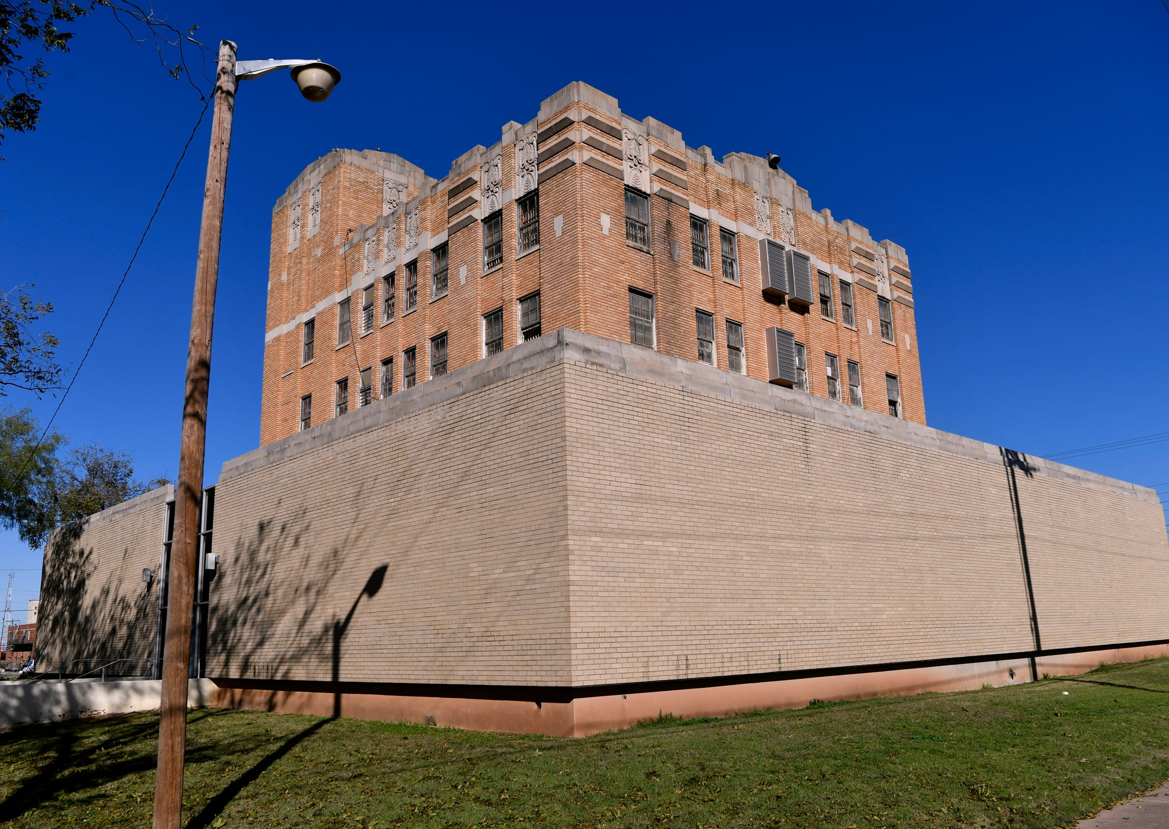 David S. Castle designed churches and schools, but there was a need for buildings for those straying from the chosen path, such as the  former Taylor County Jail. The windowless first-floor was not part of the original building.