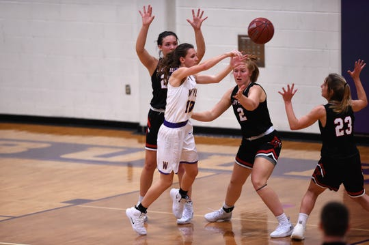 Wylie's Abbey Henson (10) passes surrounded by Lubbock Cooper defenders during a nondistrict game on Tuesday, Nov. 13, 2018, at Bulldog Gym. The Lady Bulldogs won 51-47.