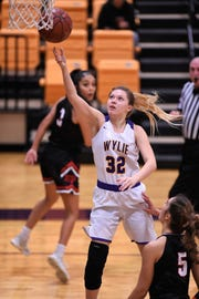 Wylie guard Skylar Williams (32) lays the ball in during a nondistrict game against Lubbock Cooper on Tuesday, Nov. 13, 2018, at Bulldog Gym. The Lady Bulldogs won 51-47.