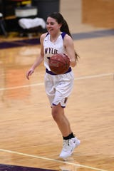 Wylie guard Mary Lovelace (24) cracks a smile while bringing the ball down court during a nondistrict game against Lubbock Cooper on Tuesday, Nov. 13, 2018, at Bulldog Gym. The Lady Bulldogs won 51-47.