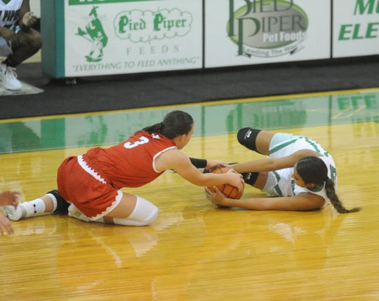 Hermleigh's Brittany Smith (3) and Hamlin's Vanessa Gonzalez fight for a loose ball Nov. 13, 2018, at Piper Court in Hamlin. The Lady Cardinals won 38-32.