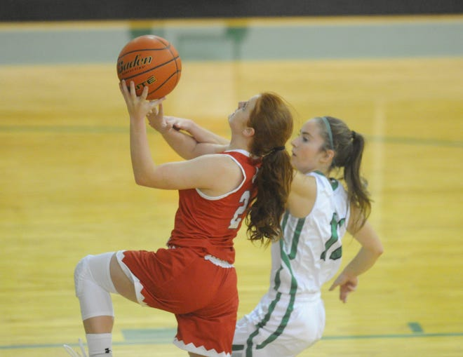 Hermleigh's Sarah Murphy (2) goes up for a layup Tuesday night at Piper Court as Hamlin's Klaire Jeffrey defends.