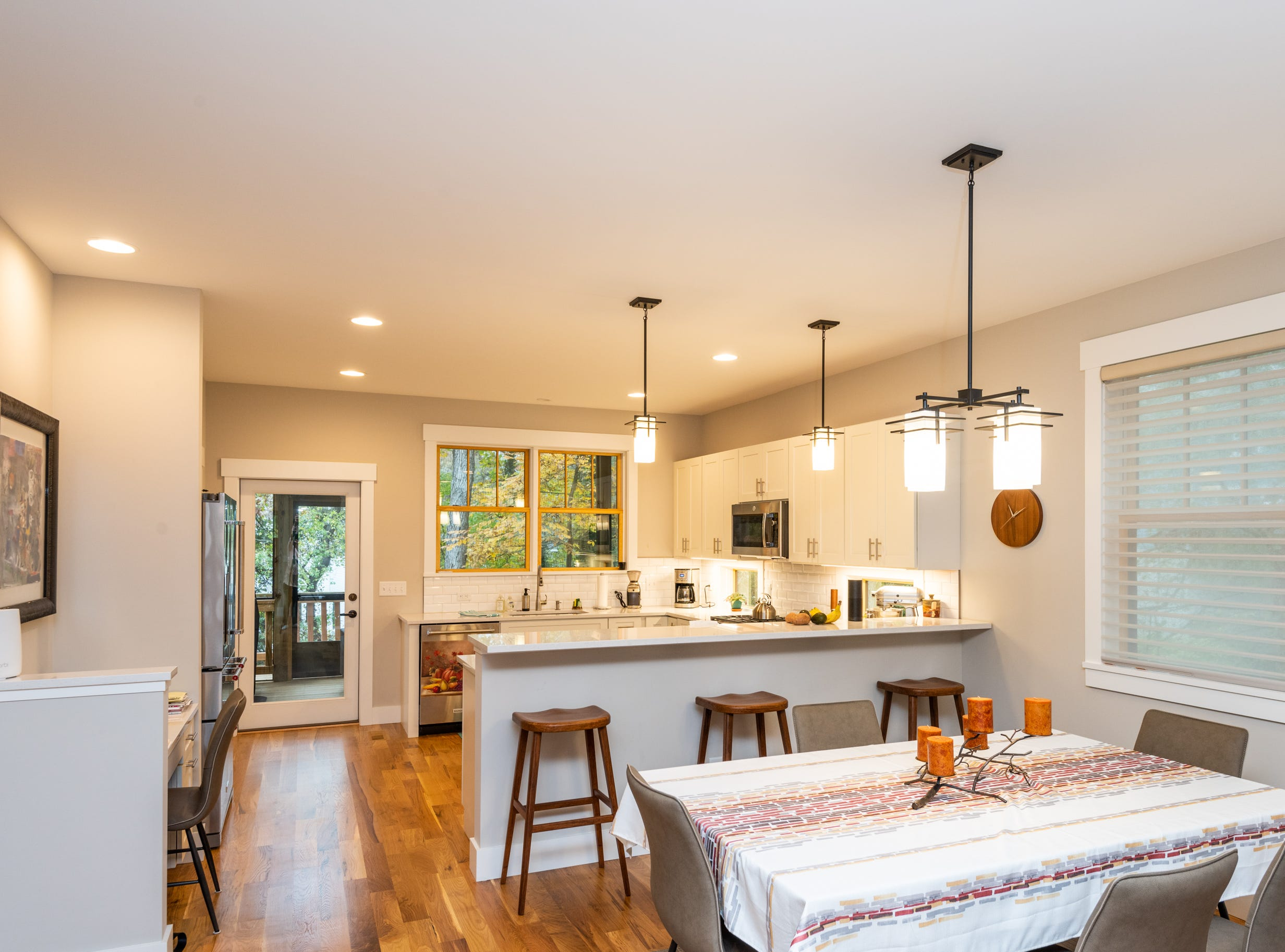 The first floor's open plan combines living room, dining area and kitchen.