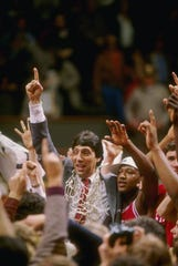 Coach Jim Valvano of North Carolina State celebrates with his team in 1983 after the Wolfpack defeated Houston 54-52. NC State's Reynolds Coliseum will be renamed for Valvano.