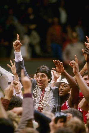 oach Jim Valvano of North Carolina State celebrates with his team in 1983 after the Wolfpack defeated Houston 54-52. The arena inside NC State's Reynolds Coliseum will be renamed for Valvano.