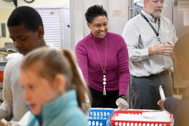 Dr. Denise Patterson, Superintendent of Asheville City Schools, helps serve students lunch during a Thanksgiving lunch at Ira B. Jones Elementary School on Oct. 14, 2018. Asheville City Schools served a special meal at all of their schools to celebrate the holiday.