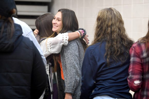 Enka senior Claire Crout is congratulated after signing to play softball at Tusculum University in an early signing day ceremony at Enka High School on Wednesday, Nov. 14, 2018.