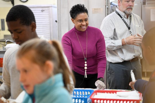 In this November 2018 photo, Superintendent Denise Patterson helps serve students and parents a special Thanksgiving-style lunch at Ira B. Jones Elementary School. Asheville City Schools served a special meal at all of their schools to celebrate the holiday. Patterson abruptly resigned June 2019 from the position, citing medical reasons.