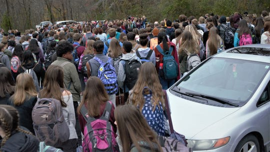 Hundreds of students gathered in West Henderson's parking lot Wednesday morning to remember Lexie Moffitt, who died in a car crash Monday.