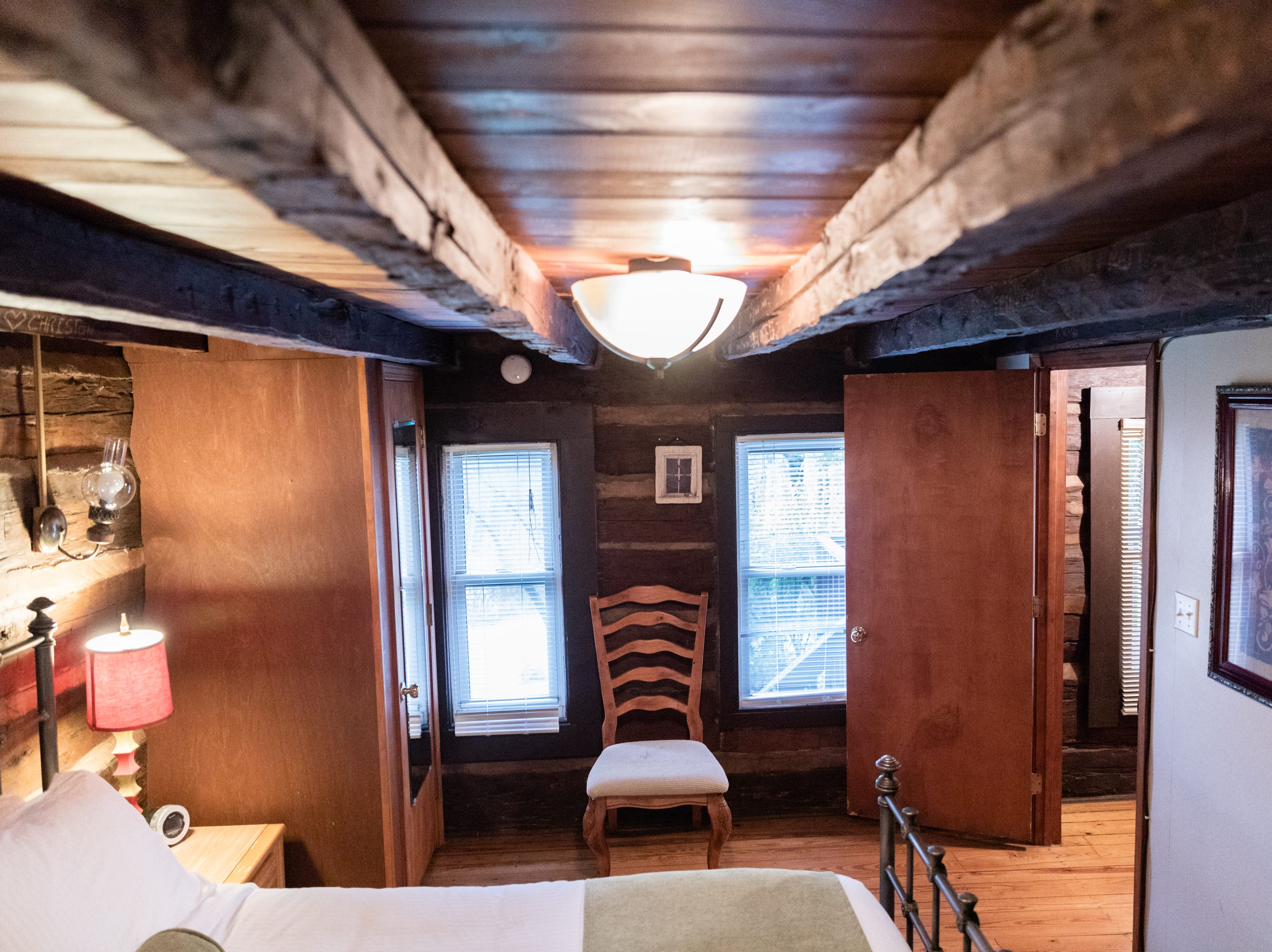 The McLeod family's Asheville Cabins of Willow Winds vacation rentals sits nestled in the woods off of Sweeten Creek Road in South Asheville, and includes two 1800's log cabins on their original site with their original working fireplaces.