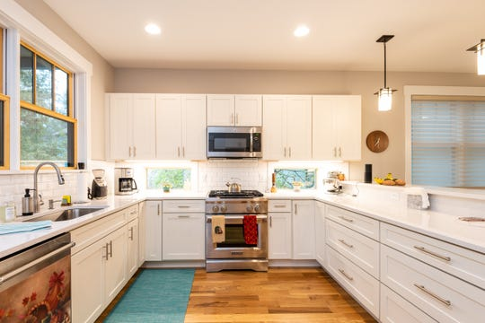 The kitchen is modern and yet has a classic look appropriate to the home.