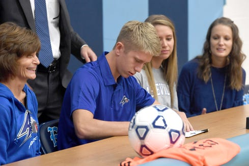 Jarrett Payne signs to play soccer at UNC Asheville in a ceremony at Enka High School on Nov. 14, 2018.