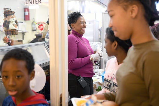 Dr. Denise Patterson, Superintendent of Asheville City Schools, helps serve students lunch during a Thanksgiving lunch at Ira B. Jones Elementary School on Nov. 14, 2018. Asheville City Schools served a special meal at all of their schools to celebrate the holiday.